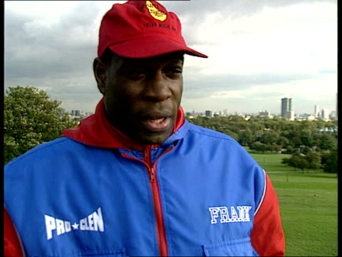 Bruno/Coetzer bout preview ITN MS Bruno along in park in track suit as shakes Staunton and chats CMS Frank Bruno intvwd SOF The bout tomorrow is...