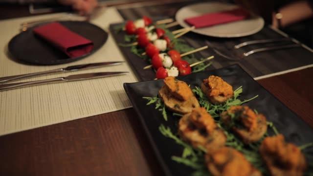 Bruschetta and Caprese salad in restaurant