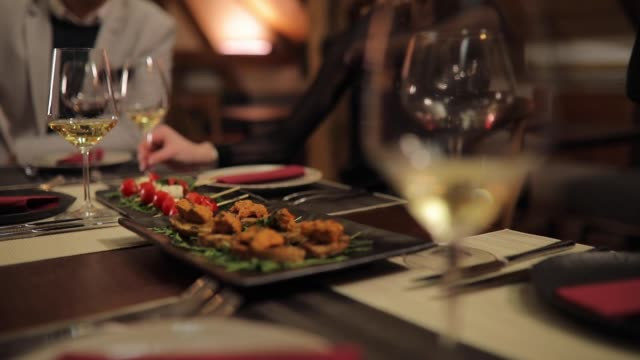 Bruschetta and Caprese salad on table