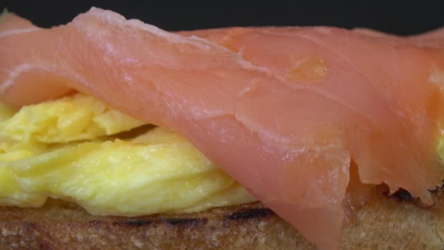 bruschetta with egg and smoked salmon - smoked food stock videos and b-roll footage