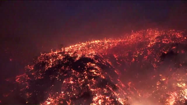KTLA A brush fire that erupted near the Getty Center early Wednesday morning burned at least four homes prompted mandatory evacuation orders in some...