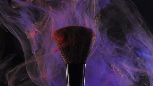 brush with blue color smoke on black background - painting art product stock videos & royalty-free footage
