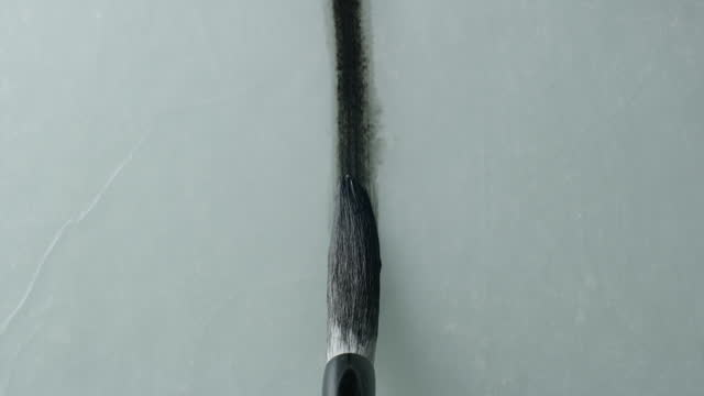 brush with india ink painting on hanji (traditional korean paper) / south korea - herunterlassen stock-videos und b-roll-filmmaterial