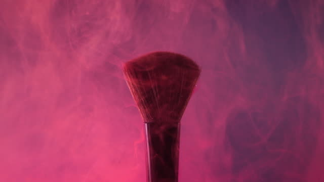 brush with pink color smoke on purple background - painting art product stock videos & royalty-free footage
