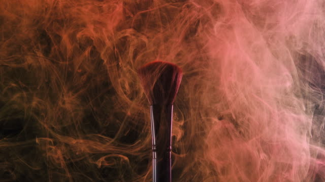 brush with red color smoke on black background - painting art product stock videos & royalty-free footage