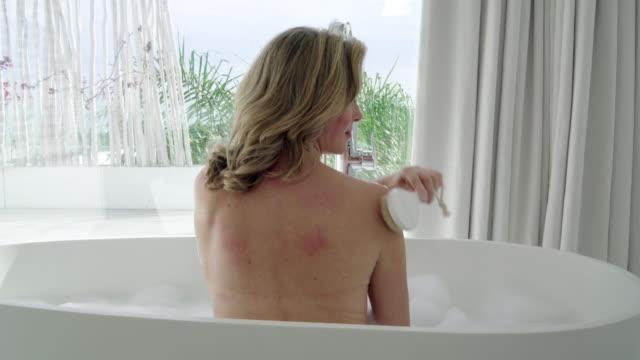 brushing back - bath stock videos & royalty-free footage