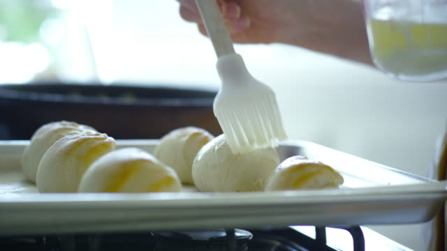 Brushing Butter onto Dinner Roll Dough