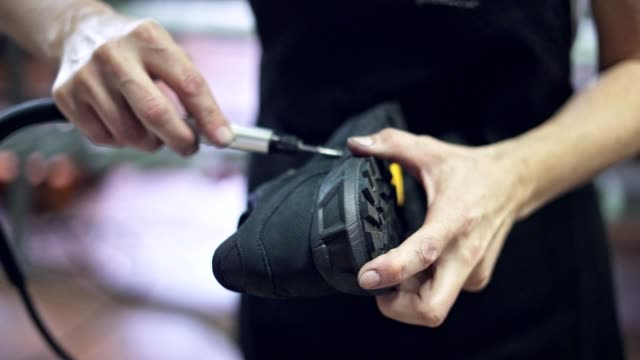 brushing glue from shoes - animal skin stock videos & royalty-free footage