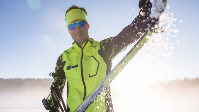 brushing snow off of skis - winter sports event stock videos and b-roll footage