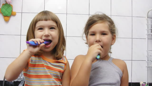 brushing teeth (hd) - toothbrush stock videos & royalty-free footage