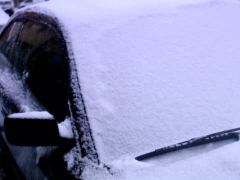 brushing the snow off the car sweden. - brushing stock videos and b-roll footage