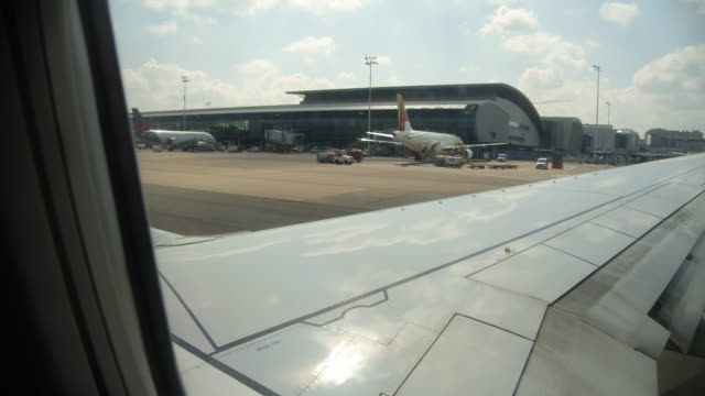 brussels airport terminal. airplane pov - banner stock videos & royalty-free footage