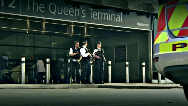 security stepped up / uk reaction england london heathrow airport armed police on guard outside terminal 2 - terrorism stock videos & royalty-free footage