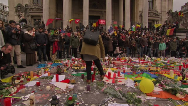 Brussels Mourns Victims of Twin Attacks Showing Exterior shots People gather at Place De La Bourse in honour of the victims of terror attacks on...