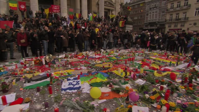 brussels mourns victims of twin attacks showing exterior shots people gather at place de la bourse in honour of the victims of terror attacks on... - city of brussels stock videos and b-roll footage