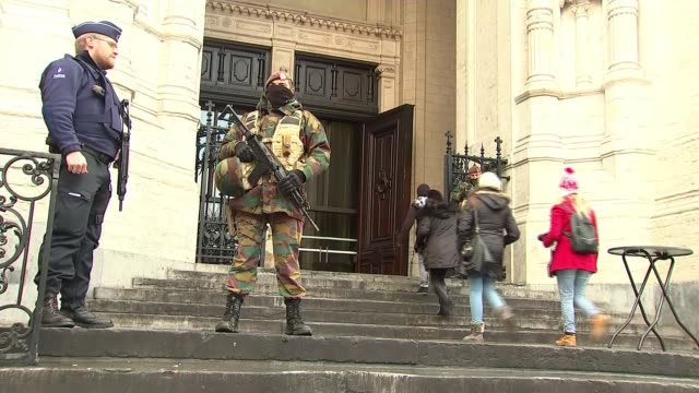 brussels on lockdown after warnings of an imminent terror attack; belgium: brussels: ext soldiers and police officer outside st catherine's church... - railway junction stock videos & royalty-free footage
