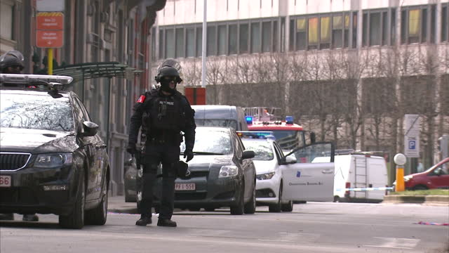 brussels targeted by suspected suicide bombers showing exterior shots police, emergency services near blast scene at brussels maalbeek metro station... - underground station stock videos & royalty-free footage