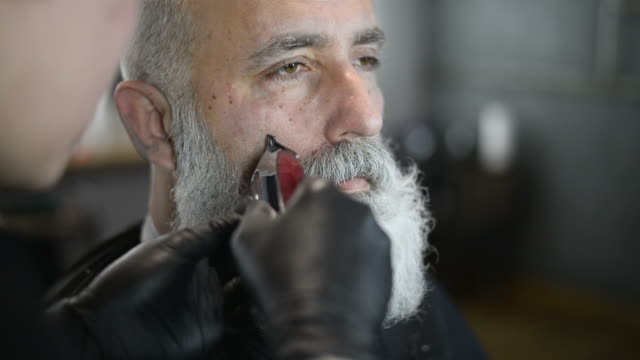 brutal barber clipper mows bearded adult senior hipster - barber shop stock videos & royalty-free footage