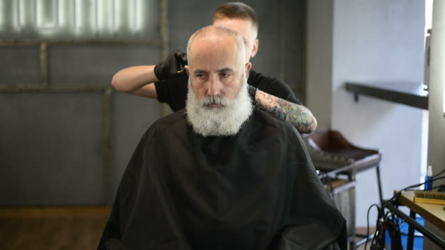 brutal barber clipper mows bearded adult senior hipster - beard stock videos and b-roll footage