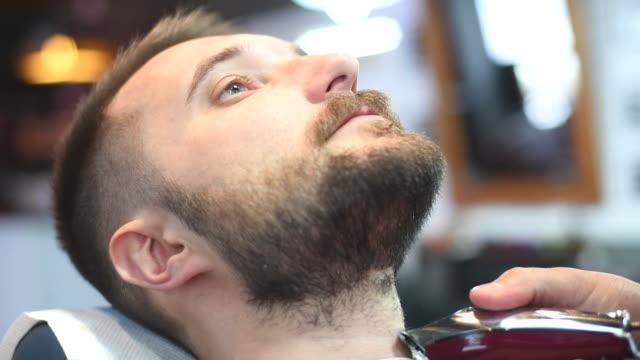 brutal barber clipper mows bearded hipster