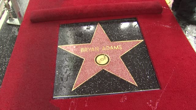 vidéos et rushes de bryan adams star at the bryan adams honored with a star on the hollywood walk of fame at hollywood ca - bryan adams