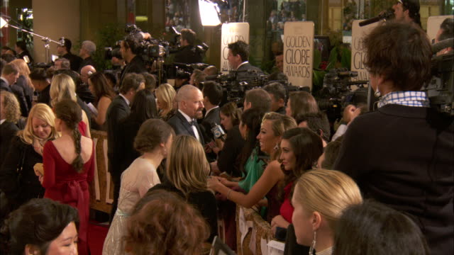 bryan cranston talking to reporter along the red carpet at the beverly hilton hotel mayim bialik interviewing nearby - mayim bialik stock videos & royalty-free footage