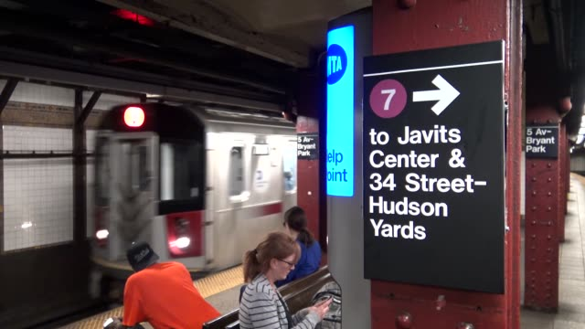 vídeos de stock, filmes e b-roll de bryant park 5th avenue is two subway stops before hudson yards which is now the last stop on the number 7 train / the new hudson yards subway one and... - number 9