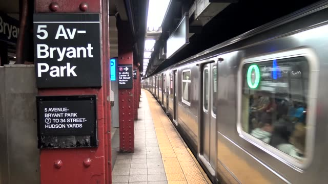 bryant park 5th avenue is two subway stops before hudson yards which is now the last stop on the number 7 train / the new hudson yards subway one and... - number 7 stock videos & royalty-free footage
