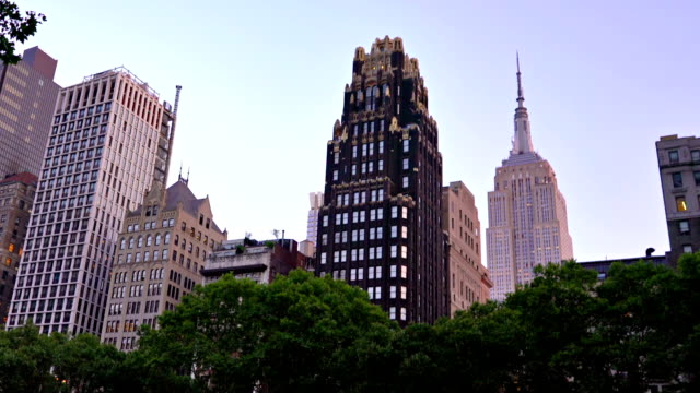 bryant park and famous building background - bryant park stock videos and b-roll footage