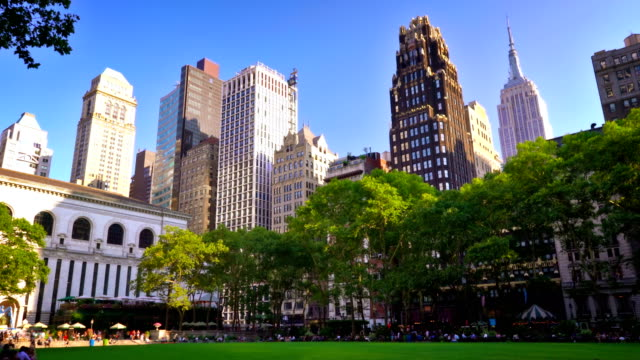 bryant park and manhattan skyline - bryant park stock videos and b-roll footage
