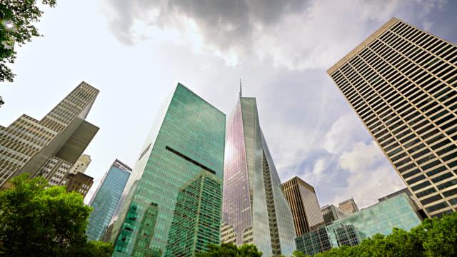 bryant park. corporate building skyline - bryant park stock videos & royalty-free footage