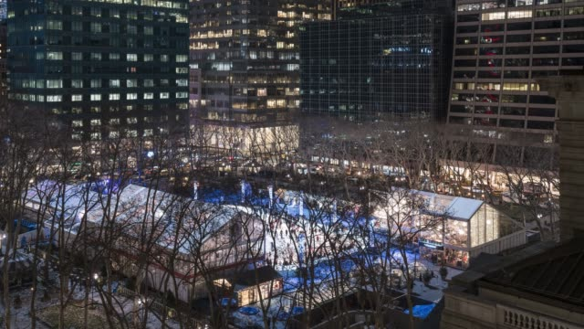 bryant park ice skating time lapse - new york - panning stock videos & royalty-free footage