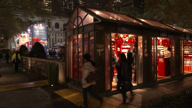 bryant park, nyc - christmas holiday shops (night) - bryant park stock videos and b-roll footage
