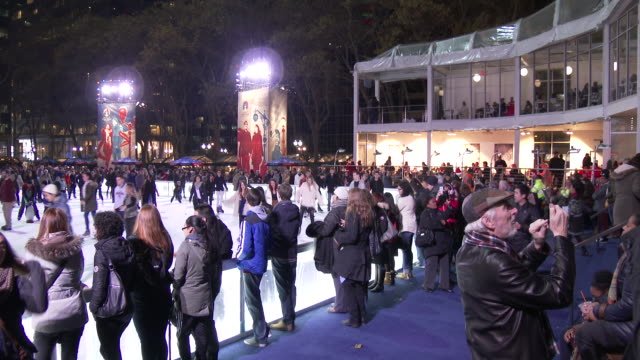 Bryant Park, NYC Ice Skaters - Ice Skating Rink (Christmas Season)