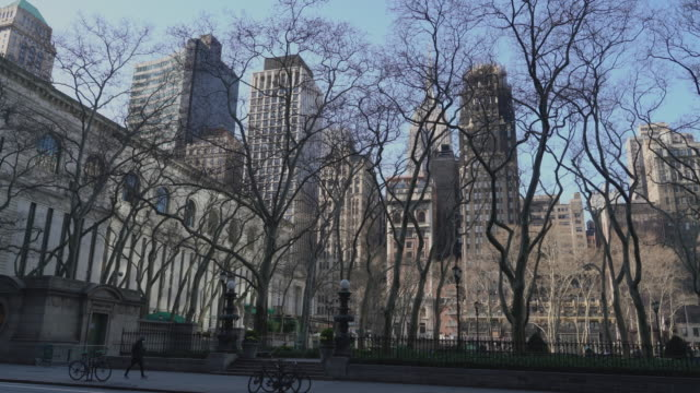 bryant park, one of the popular destinations for new yorkers and tourists, is quiet and deserted because of the covid-19 outbreak. - bryant park stock videos & royalty-free footage