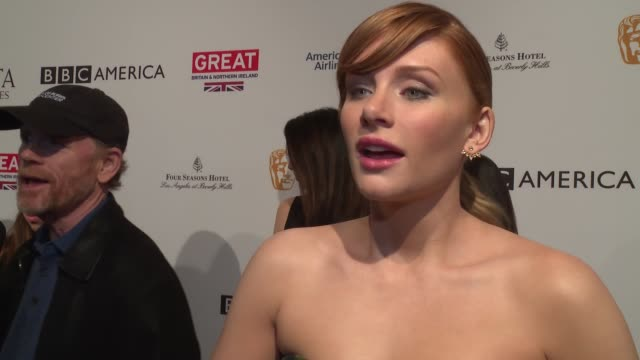 interview bryce dallas howard on coming to the bafta awards tea party with her dad jokes that she needed a ride and they were both invited on her... - tea party stock videos and b-roll footage