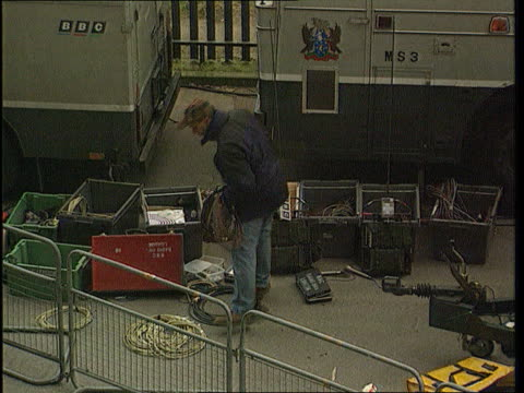 bskyb live soccer deal; tx 2.2.96 itn england: twickenham: ext tlms row of bbc outside broadcast vans tbv technician sorting out boxes of equipment... - bbc stock-videos und b-roll-filmmaterial