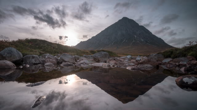 Buachaille Etive Mòr is refected in the still waters of the river Coupall at the head of Glen Etive in the Highlands of Scotland
