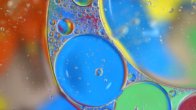 bubble oil colorful on water - essential oil stock videos & royalty-free footage
