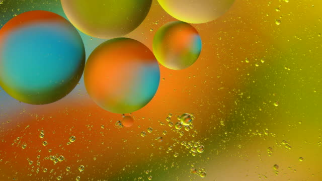 bubble oil on water abstract backgrounds colorful - essential oil stock videos and b-roll footage
