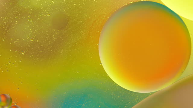 bubble oil on water colorful abstract backgrounds - essential oil stock videos & royalty-free footage