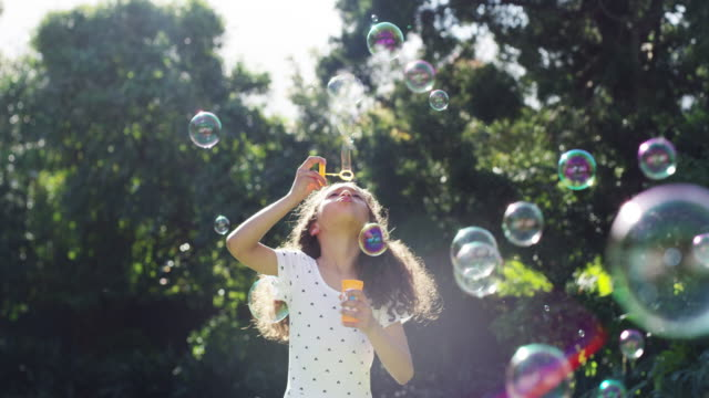 bubbles all around! - bubble wand stock videos & royalty-free footage