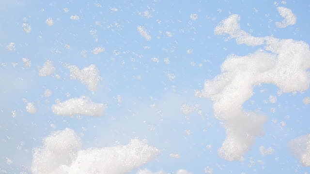 bubbles in blue sky - foam stock videos & royalty-free footage