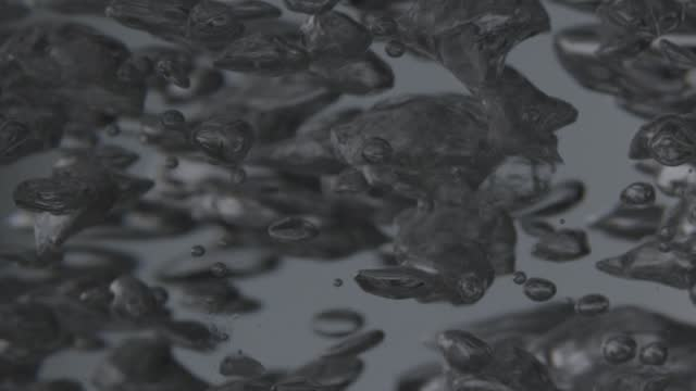 bubbles in boiling water - loopable moving image stock videos & royalty-free footage