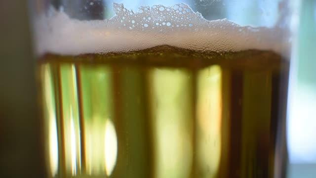 Bubbles inside a glass of SABMiller Miller High Life brand beer in Tiskilwa Illinois US on Wednesday Sept 16 2015 Shots Close up shot of bottle of...