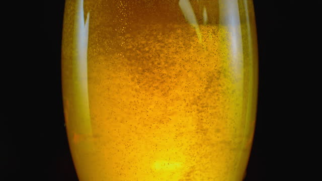 slo mo ld bubbles moving in a glass of beer - beer glass stock videos & royalty-free footage