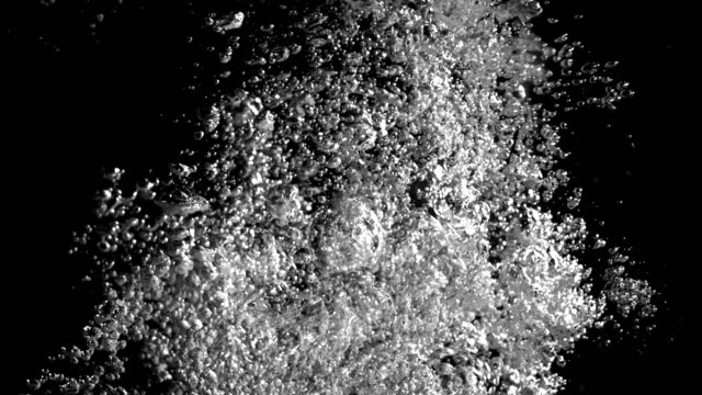 bubbles rising against a black background. 4k - man made stock videos & royalty-free footage