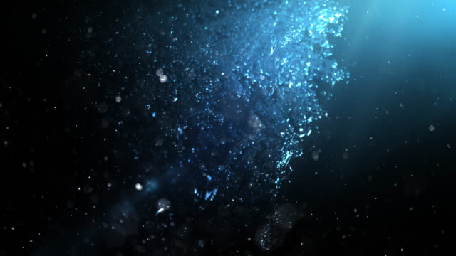 bubbles rising underwater in a dark sea. 4k - deep sea diving stock videos & royalty-free footage