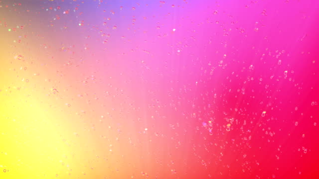Bubbles rising up on color background