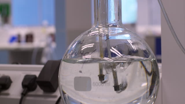 Bubbling Volumetric Flask in a Chemistry Lab